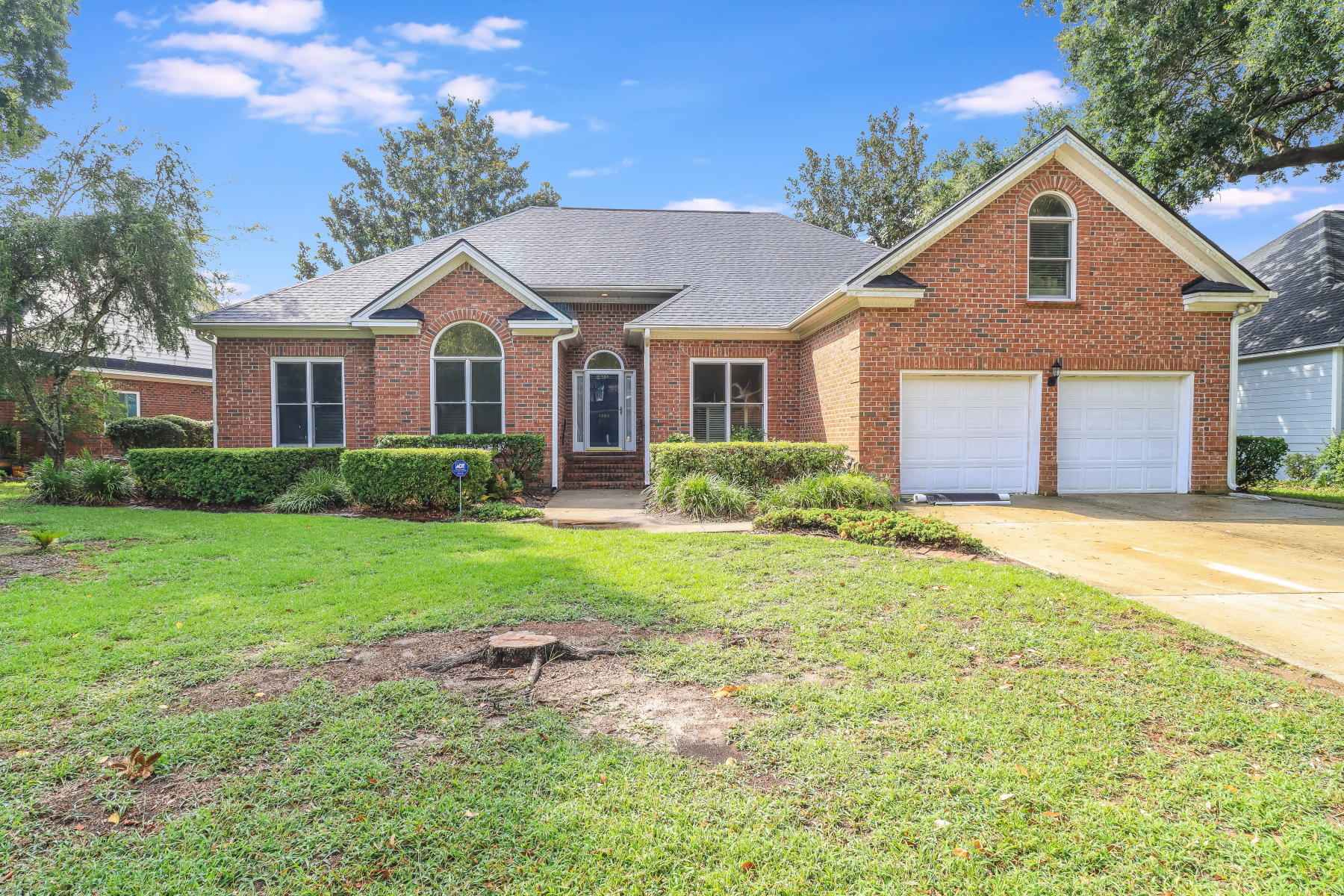 This beautiful brick home is ideally nestled on a canal that opens out to a 50-acre fresh water lake! Hidden Lakes is one of the most desired neighborhoods in the area and offers a community pool, clubhouse, tennis courts and a play park. Kayak, canoe or paddleboat to the lake's gazebo from your very own NEW private dock. Outside, this home also has a relaxing NEW rear deck and a brand NEW ROOF! Inside, the floor plan offers tons of space with 5 bedrooms, 3 full baths, 2 separate living spaces, plus a large bonus room over the garage. Large windows matched with high ceilings throughout the home bring the wonderful water views in and create an open and airy ambiance. On the first floor, the well-planned layout offers two bedrooms that share a full bath, as well as an expansive master suite. This space boasts a tray ceiling, a large walk-in closet, and a private bath with a double sink vanity, a garden tub, and a separate shower. The second floor consists of two bedrooms, a full bath, and a bonus room, with a closet the size of a room, as well as additional storage space. Hidden Lakes has so many wonderful features including neighborhood irrigation which allows you to water your yard at no additional cost, and even boat storage available for an extra fee. Tennis and basketball are included in the community area and you can even rent out the clubhouse for special events. Plus, this neighborhood is located just minutes from the Isle of Palms and across the street from the conveniences of Seaside Farms. The Towne Center, Sullivan's Island, Shem Creek, and so much more are just minutes away!