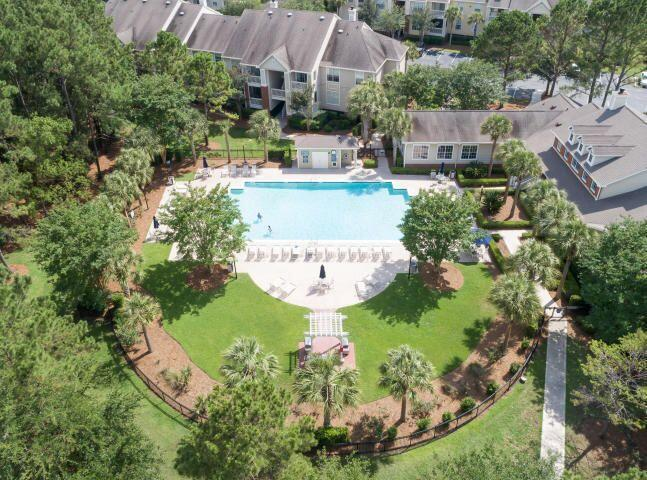 Motor, bike or walk just over the bridge to front beach Isle of Palms.   Longgrove in Seaside Farms offers a lovely pool & clubhouse with work-out/gym facilities & a business center.  Seaside Farms has several restaurants, Target, Harris Teeter, barbers & doctors within walking distance.  This unit is upstairs on the 2nd floor with a screened porch.  Maintained over the years, but not updated yet. Some neighborhood boat parking is available by permit.  Please no short term vacation rentals.