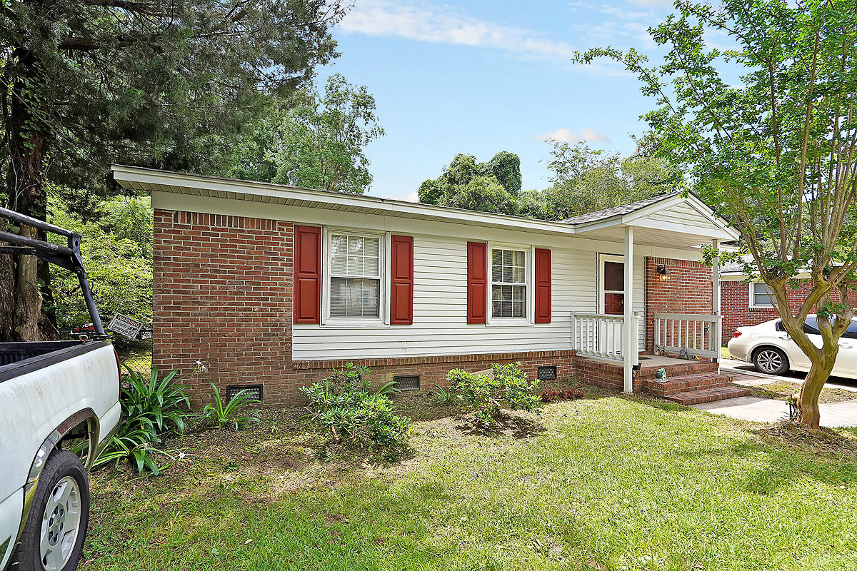 This charming brick ranch home is nestled within a quiet and established Mount Pleasant neighborhood. This is a great location that's close to everything! It's also not in a flood zone. The home has been well-kept and the owner has resided there since 1994. As you enter, you're greeted by a functional floor plan, with a great flow for entertaining and everyday living. The kitchen offers ample cabinet and counter space. Refrigerator to convey, with an acceptable offer and as part of the sales contract. The updated bathroom features new flooring and a new shower. The home also features a spacious addition with access to the backyard. The large fenced-in backyard, with a large Fig tree, will be perfect for grilling out, entertaining, or watching the kids and pets play. Conveniently located near shopping, dining, Downtown Charleston, and area beaches. Come see your new home, today! **Home is being sold as-is. Seller will make no repairs.**