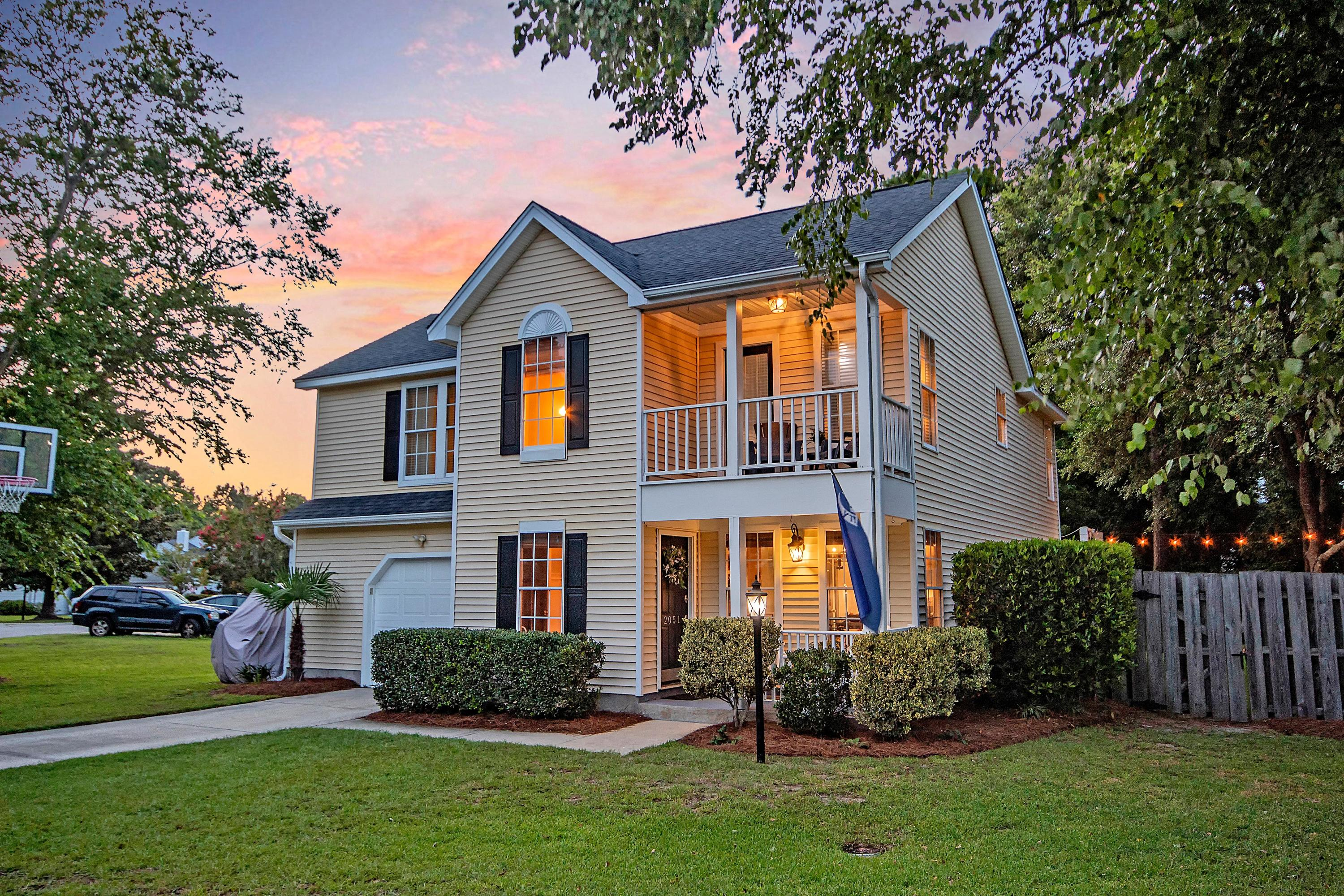 This beautifully updated Charleston style home is located only 4 miles from the beach and is within a short walk or bike ride to Town Center, Seaside Farms and Six Mile Shopping Centers, where you can enjoy fantastic restaurants, grocery stores, and shops.  The home is situated on a corner lot which boasts one of the largest properties in the neighborhood.  Relax on the front porch and watch native birds and the mature trees in the front yard.  Upon entering the home, you are greeted with a large, vaulted foyer with a powder room, which opens up to an updated kitchen and breakfast nook.  You will love cooking for friends and family in the kitchen which has ample lighting, cherry wood cabinets, stainless steel appliances, granite countertops and white backsplash. The separate dining room is perfect for entertaining and is open to the grand living room which features 18 ft ceilings, a wood burning fireplace, and plenty of room for a comfortable couch where you can relax after a long day.  Upstairs the large master bedroom feels like a sanctuary with the updated master bathroom and custom storage walk in closet.  The master bathroom features double sinks, a large shower with two shower heads, and plenty of storage space.  Two additional bedrooms share the second full bathroom, and guests can enjoy spending time outside on the second-floor front porch.  Outside in the backyard you will find beautiful oak trees, a back patio with a custom-made pergola, a nearly new playset, and a large shed, both of which convey with the property.  The home also includes many small fruit trees including two orange trees (one left of the driveway and one in the backyard), avocado, lemon, and lime trees in the backyard, and mulberry and peach trees on the side yard near the shed.  A golf cart parking area is located on the left side of the house adjacent to the rose bushes (please note the golf cart and the basketball hoop do not convey).