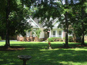 569 Woodspring Rd-Custom built home in a very unique neighborhood filled with trees, ponds and large lots, crabbing dock and picnic area. This home sits in the middle of 1.38 acres with room to grow!