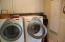 Full size washer & dryer, with ironing board mounted in the wall cabinet