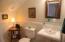 Guest room (BR#3) - half bath. (Full bath with tub shower in the hallway.)