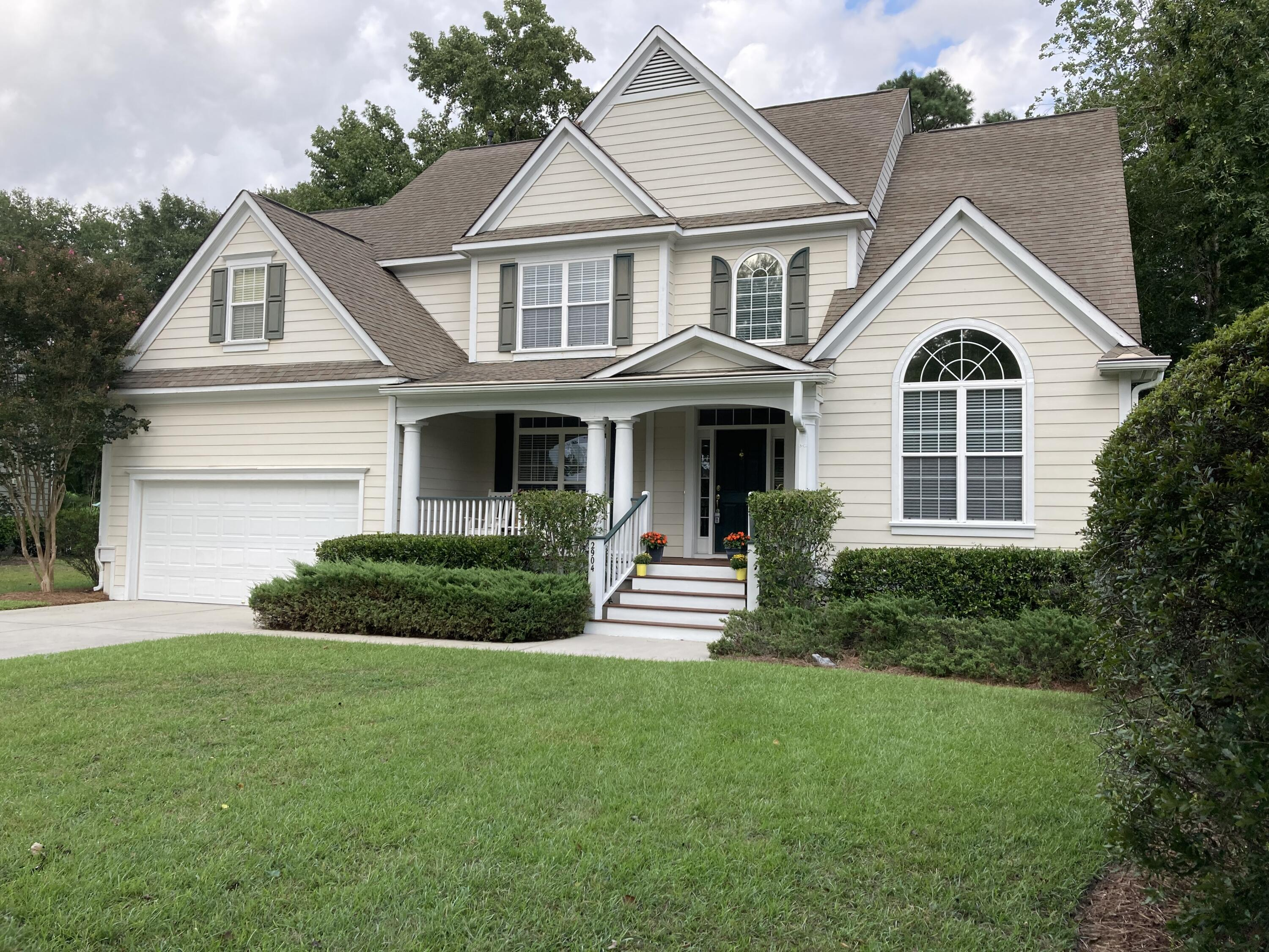 Located in gated Dunes West community, this beauty will delight with 2-story windows in the central room that's open to kitchen with countertop bar, upgraded cabinets, granite, stainless, and eat in area that overlooks tree lined backyard. 1st floor MBR and bath take in views of yard and trees, too!  Unused 2nd floor holds 3 more bedrooms, bath and tons of storage - possibilities for expansion. Meticulously maintained with 2 new gas furnaces, 2 new air conditioners, hot water heater, dishwasher and refrigerator. Recent exterior paint job and gutters w/ leaf guard. The screened porch and deck add to enjoyment of this beautiful home and private lot. Resort amenities include 3 pools, tennis club, workout center, golf course, boat launch and storage and miles of paved walks with marsh views.
