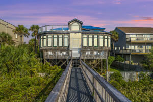 Imagine living in your dream beach front home where you can watch the sun rise and be just steps from the sand and surf. Imagine sweeping ocean views from your bed, dining room, great room or even the kitchen. This amazing home offers all this and much, much more!The home was completely renovated in 2019 and no expense was spared. Included are all new appliances, new HVAC, new water heater, new roof, floors were all refinished, new carpet, new deck, all new bathrooms, and new countertops. Remote control shades, and an elevator were also installed during the renovation.In addition , the home has been professionally decorated and comes fully furnished. There is a huge bunk room that can sleep up to 12 people with a tv sitting area. . In addition to three other rooms with queen size beds, the owners suite has a king size bed and a sitting area with beautiful beach front views.  Each bedroom has its own full bathroom attached as well. (The two guest room on the main level do not have closets)  The fabulous floor plan has plenty of space for entertaining. There's a huge deck on the main level, a screen patio on the ground level and a new sun porch on the upper level.  This beachfront home is also walking distance to Center St where you can dine and shop with family and friends. Don't miss out on this incredible opportunity!