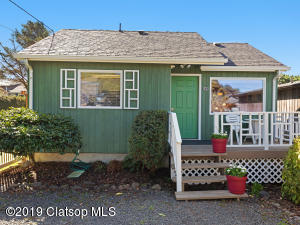 Darling, low-maintenance cottage with two parking spots on a quiet street.