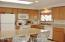 Recently remodeled kitchen with skylight for casual entertaining at the beach.