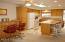 You know everyone always congregates in the kitchen, so make it spacious & enjoy!