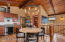 Roomy dining area, tile flooring, warm wood tones invite entertaining beach style.