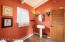 Rich colors & exotic light fixtures add interest to spacious 1/2 bath on main.