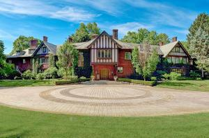 Gracious circular paver patio welcomes visitors to this grand estate.