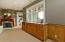 Built-in cherry and maple under-window cabinets. Cozy fireplace in Master Suite Sitting Room.