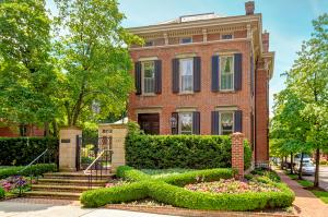 The crown of German Village, this home gracefully overlooks Schiller Park.