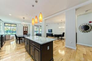 Open floor plan with walls of windows for east sun and park views.