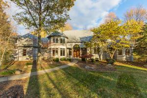 Incredible Stone & Stucco Estate~ Truly Special setting 3.9 acres w/ an additional 14.9 acres available w/ Barn & Riding arena available ( separate purchase) Just outside your back door... amazing wooded land... Amazing Possibilities to own nearly 20 acres so close to everything.