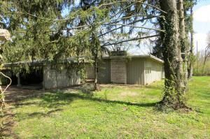 This 2060 square foot cottage is in need of major repairs, but sits on a separate parcel from the larger main house.