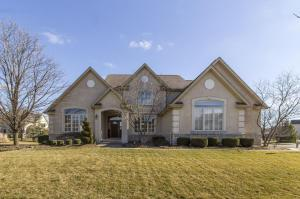 Beautiful custom home located in desirable Harvest Wind