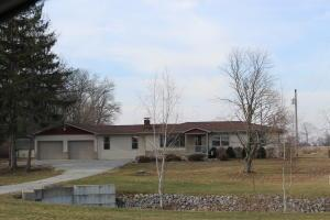 Lovely country home on 2 acres (2-1 acre lots). Koi pond, stream in front. Country fields in front & behind. 3 car, attached garage with 10' doors & all with openers.