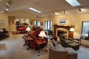 Open and inviting Living Room and Dining Room with skylights and windows for lots of natural light.