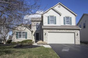 Stone & vinyl exterior, asphalt drive, backs to golf course with views of 6th/7th/8th greens, front porch light, white 6 panel doors, window shutters, coach lights, keyless entry, lever locks, front screen door, satellite dish, first floor Master, first floor Laundry, screened porch