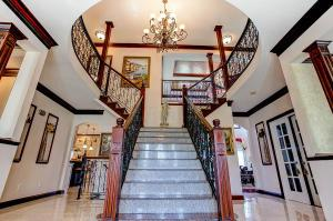 Welcome to 7044 Optimara Drive, The most beautiful bridal staircase is all granite!