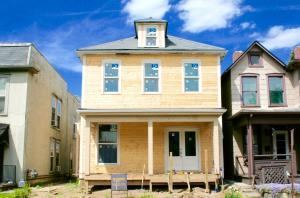 Beautiful Victorian Village Restoration with all new wood siding, windows, door and porch!