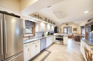 Expanded kitchen with newer stainless appliances, quarts counters, and refinished cabinets.