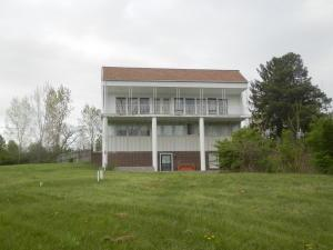 Unique 3 story home. Updated features include 2nd bath remodeled, 3 dimensional roof and plywood (2007), septic lines (2012). Large outbuilding (24'04 x 32'03) with dirt floor. Easy access to shopping, dining, parks and medical.