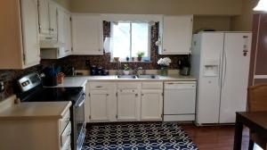 Nice size Kitchen with Eat In Space with new backsplash. All Kitchen Appliances stay.