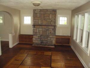 Inlayed wood floors, decorative fireplace