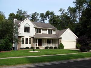 Four bedroom, 3.5 bath home, on a beautiful flat lot, with a finished walk-out basement. Primary Image