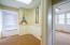 Overhead lighting, wainscoting and privacy glass