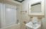 Shower tile surround, linen closet