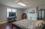Decorative Fireplace, overhead light and laminate flooring