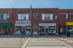 2 store-fronts with 2 three bedroom apartments above.