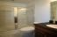 Adjacent to the Multi Purpose Rooms. Vanity with granite counter top. Glass shower/tub. Ceramic tile floor.