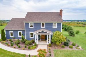 Colonial-style 2-story home with 5 bedrooms and 3 full baths