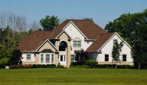 Great curb appeal, set back from the road with wooded mature trees behind