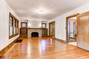 """24' x 13'6"""". Large living room with woodburning fireplace."""