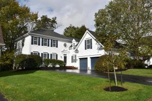 This elegant home sits on a quiet treelined street walking distance to great shopping and schools