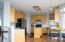 Great kitchen with lots of cabinets and counter space! Center island and breakfast bar. Wood laminate flooring.