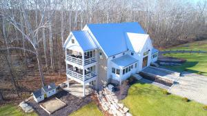 Stone and hardiplank exterior, asphalt and paver drive, ~10 acre protected area, wooded lot, backs to Reserve and the River, composite deck, 4 panel doors, geothermal heat with electric backup, DelCo water and sewer.