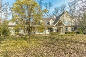 Stone, stucco & wood exterior, concrete drive, 3+ car side entry Garage, wooded lot, coach light, front covered porch, front porch lights, DelCo water, interior painted 05/2017, security system, first floor Master Suite, fenced yard