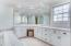 Large Master Bath with window looking out to yard and reservoir.