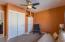 Neutral carpet and overhead light/fan combo.