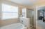 Large garden soak tub and walk in shower with tile surround.