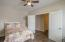 Double doors and ceiling fan/light combo.