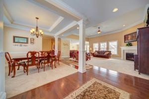 Open and flowing floor plan with hardwood floors and neutral carpeting
