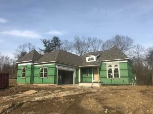 Coming along! This home will feature a custom stone and stucco exterior.