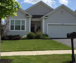 Front view of this charming ranch style home with an enormous finished lower level.